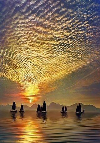Boats and gold sky image